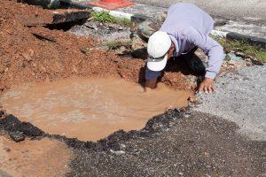 Irrigation Technician Repairing Water Main